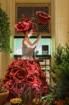 14,768 hand-cut petals create the flowers used on the dresses of the figures